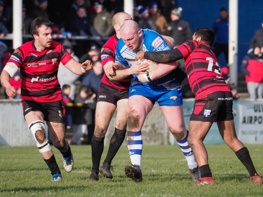 Carl Forster in action for Barrow