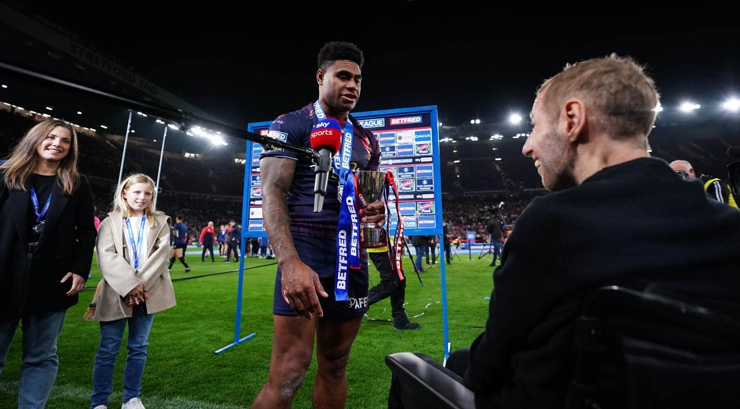 Kevin Naiqama of St Helens being presented the Harry Sunderland Trophy by Rob Burrow